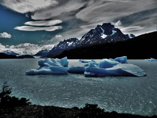 The abnormal hot weather is causing all the nearby glaciers to break up and melt – this one is already retreating at a rate of several metres a year. (Torres del paine)